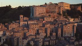 Aerial view of Sorano, Grosseto, Tuscany, Italy. Landscape at the sunset of the medieval village on the hill. Aerial view of Ancient Sorano town in Tuscany stock video