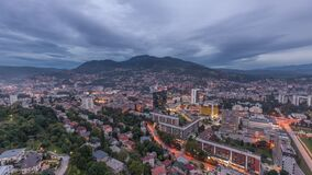 Aerial view of the southern part of Sarajevo city day to night time lapse. stock footage