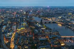 Aerial view of Southwark district in London at dusk. Aerial view of Southwark district in London on a cloudy day at dusk royalty free stock images