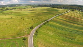 Aerial view of the sown fields near the motorway.  stock video