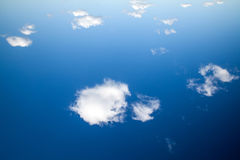 Aerial view from space, white clouds at bright cyan blue sky. Royalty Free Stock Photography