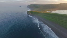 Aerial view. Span over the shore at sunset. The most beautiful flight over the sea at sunset. stock footage
