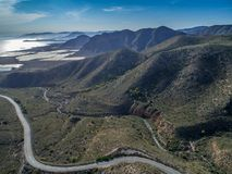 Aerial view on spanish mountains and a road to the sea with loops. Cartagena, Costa Blanca, Spain stock photography