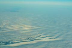 Aerial view of special clouds over United Kingdom. From a window seat in an airplane stock photo