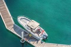 Aerial view of speed boat and floating dock. Aerial view of speed boat on the pier. Holiday and fun concept Royalty Free Stock Images