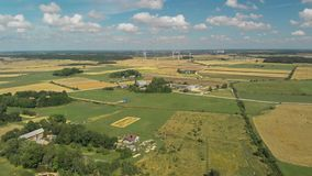 Aerial view of spinning wind turbines stock video