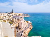 Aerial view on the Spinola Ba. ST.JULIAN`S, MALTA, MAY 15, 2018 - Aerial view on the Spinola Bay with outside pool in St.Julian`s from above - St.Julian`s, Malta Stock Photo