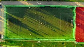 Aerial view of a sports field with footballers playing, Poland stock footage