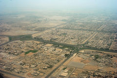 Aerial view of sprawling town. Aerial view of highways through sprawling town in arid landscape royalty free stock image
