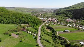 Moving up drone above mountain village road stock video