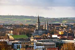 Aerial view of St Fin Barre cathedral with mountains in Cork, Ireland royalty free stock photo