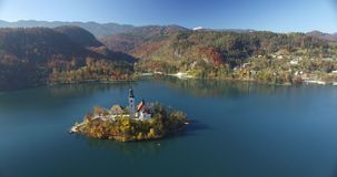 Aerial view of St Martin church on island and Bled stock video footage