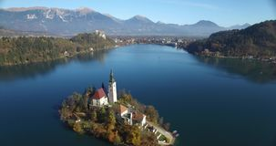 Aerial view of St Martin church on island and Bled stock footage