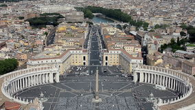 Aerial view of St.Peter's Square. (Piazza San Pietro) and Vatican Museums (Musei Vaticani) in Vatican, Rome. Panning down from the Tiber river in the background stock video footage