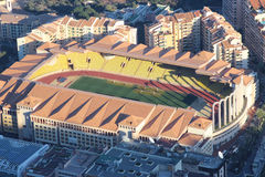 Aerial view of Stade Louis II and Fontvieille. Fontvieille, Monaco - March 18, 2016: Aerial view of Stade Louis II and Fontvieille District in Monaco, south of Royalty Free Stock Photo