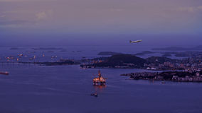 Aerial View of starting Plane in front of Oil Rig Drilling Platform Royalty Free Stock Photos