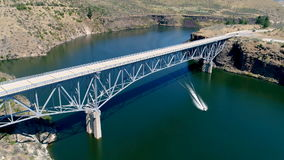 Aerial view of a state highway as it crosses a waterway stock footage