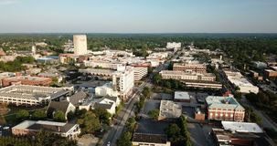 Aerial View Static Shot Over Main Street in Spartanburg South Carolina. Automobiles travel Main Street in late afternoon in Spartanburg SC stock video footage