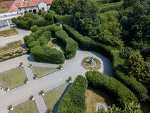Aerial view of a statue and a flowering garden with flowerbeds and vases Stock Photo