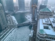 Aerial view of steamy, foggy morning over Chicago River, where chunks of ice float stock photos