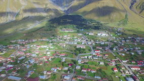 Aerial view of Stepantsminda, Georgia stock video footage