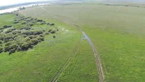 Aerial view of in the steppe Kazakhstan with mud road. Aerophotography stock video