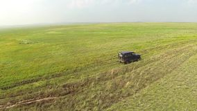 Aerial view of in the steppe off-road car at road stock video