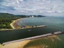 Aerial view of stone breakwater and beach at Pranburi Estuary. Aerial view of stone breakwater and sand beach at Pranburi Estuary Royalty Free Stock Image