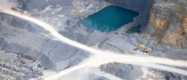Aerial view : Stone quarry with a turquoise pond Royalty Free Stock Photos