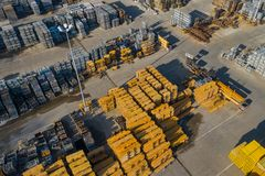 Aerial view of storage place. Construction materials in industrial city zone from above. Top view. Photo captured with drone.  royalty free stock photo