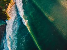 Aerial view of stormy waves at sunset. Biggest ocean wave with green tones Royalty Free Stock Image
