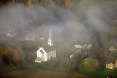 Aerial view of Stowe, VT in Autumn on Scenic Route 100, through fog Stock Photo