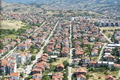 Aerial view of strait streets and red rooftops in small town Royalty Free Stock Photography