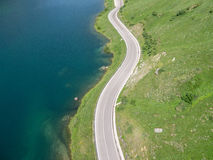 Aerial view of the street mountains with lake. Italy Royalty Free Stock Photography