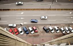 Aerial view on street with parking lot and cars. Top aerial view on street with parking lot and cars. Urban scene with traffic, horizontal lines Stock Photos
