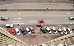 Aerial view on street with parking lot and cars. Top aerial view on street with parking lot and cars. Urban scene with traffic, horizontal lines Stock Images