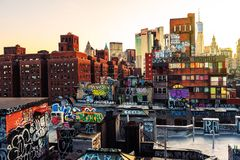 Aerial view of a street with various graffiti. Skyscrapers at the background in New York, USA Royalty Free Stock Photography