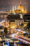 Aerial view of the streets near to the Parliament of Budapest in Hungary. Aerial view of the streets at night and the river Danube, near to the Parliament of Royalty Free Stock Photos