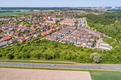Aerial view of a suburb on the outskirts of Wolfsburg in Germany, with terraced houses, semi-detached houses and detached houses,. Arable land in the foreground Royalty Free Stock Images
