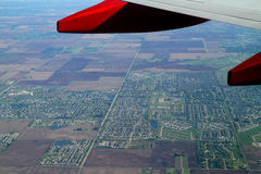 An aerial view of suburban landscape seen through an airplane window Royalty Free Stock Photography