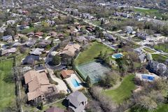Aerial View of Suburban Neighborhood. Aerial view of a neighborhood in the suburban Chicago area with homes, parks, tennis courts and swimming pools Stock Images
