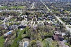 Aerial View of Suburban Neighborhood. Aerial view of a neighborhood in suburban Chicagoland with homes, parks, baseball diamonds and swimming pools Stock Photo