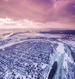 Aerial view of Suburban town next to a river and fields at sunset in winter. Stock Photo