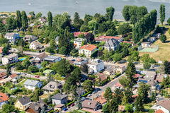 Aerial View Of Suburbs Houses Roofs In Vienna City. VIENNA, AUSTRIA - AUGUST 25, 2015: Aerial View Of Suburbs Houses Roofs In Vienna City From Donauturm (Danube Royalty Free Stock Photos
