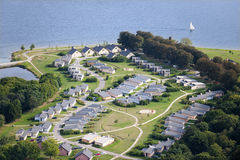 Aerial View : Summer camp along a lake. With a sailboat Royalty Free Stock Photos
