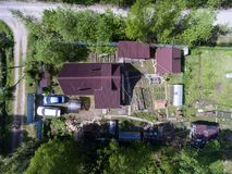 Aerial view at summer cottage with house, garden, barns and sauna, Russia Royalty Free Stock Images