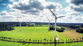 Aerial view of summer countryside with wind turbines stock video footage