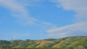 Wind turbine with clouds . Aerial view of summer countryside with wind turbines stock footage