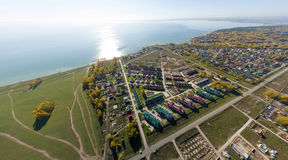 Aerial view of a summer house village at blue sea coast. Royalty Free Stock Photos