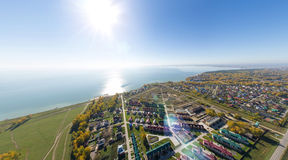 Aerial view of a summer house village at blue sea coast. Royalty Free Stock Image